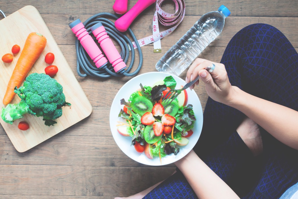Yoga female cooking homemade salad